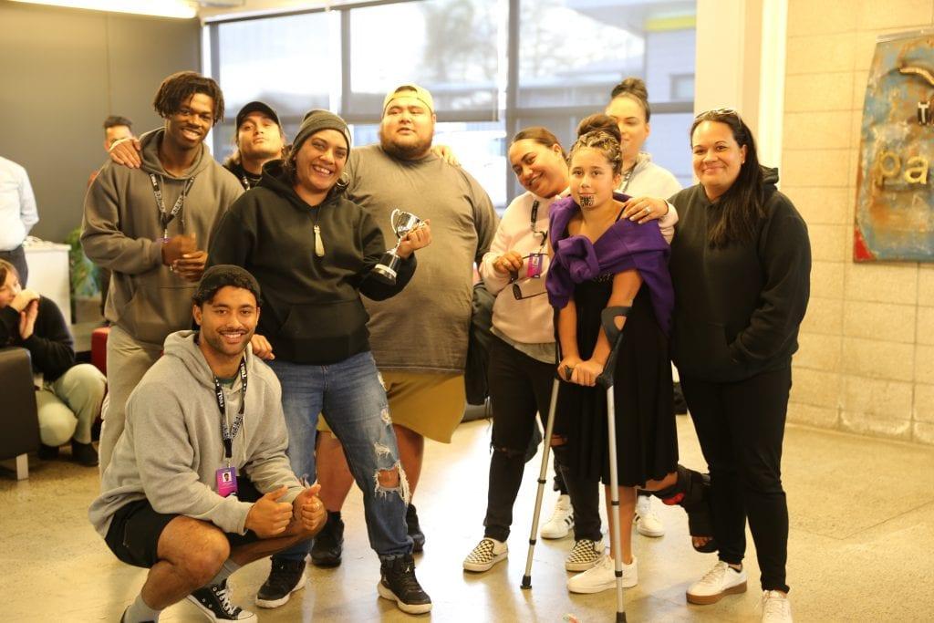 The Real Te Hononga team with their trophy.